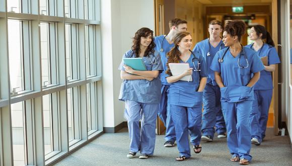 medical students walking together in hallway