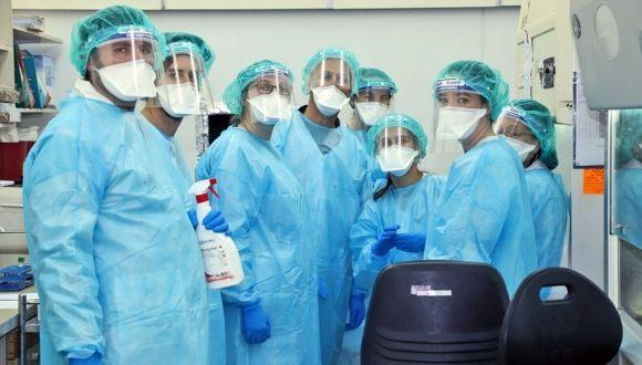 volunteers at Sheba Medical Center wearing protective gear